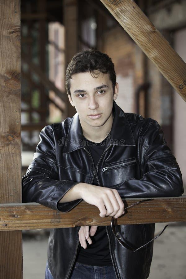 Teenage boy in black leather jacket. royalty free stock photo