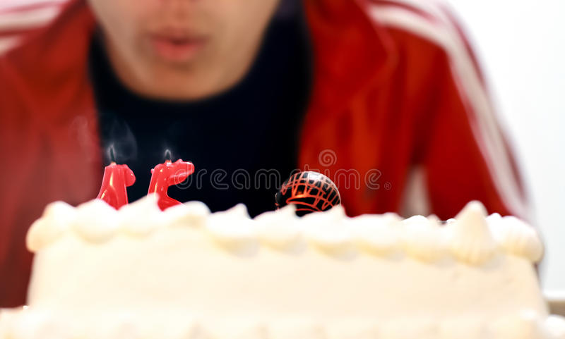 Blowing out the candles stock image
