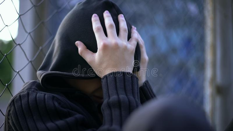 Teenage boy crying, school bullying, dysfunctional family, loneliness depression. Stock photo royalty free stock photography