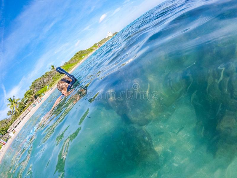 Teenage boy does snorkeling royalty free stock images