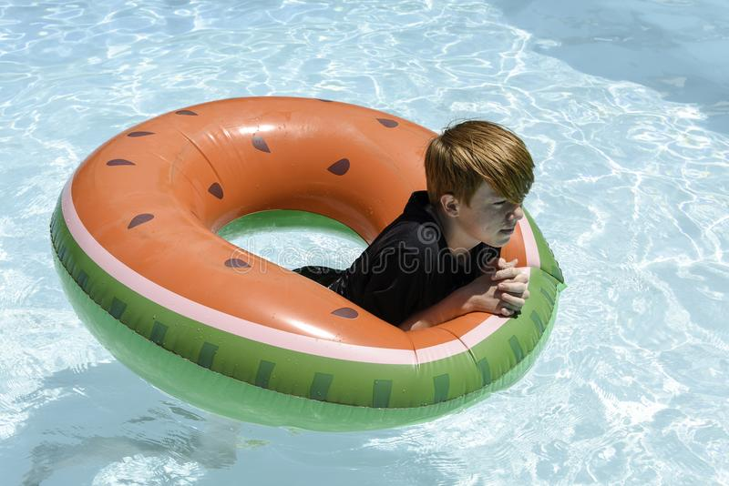 Teenage boy in floatie royalty free stock photos