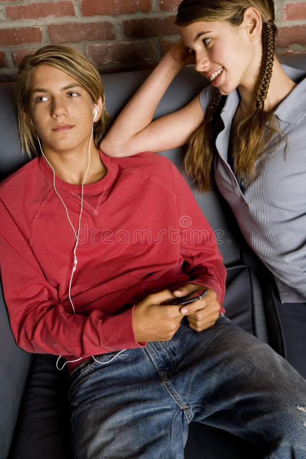 Flirting And Listening To Music Stock Photo - Image of