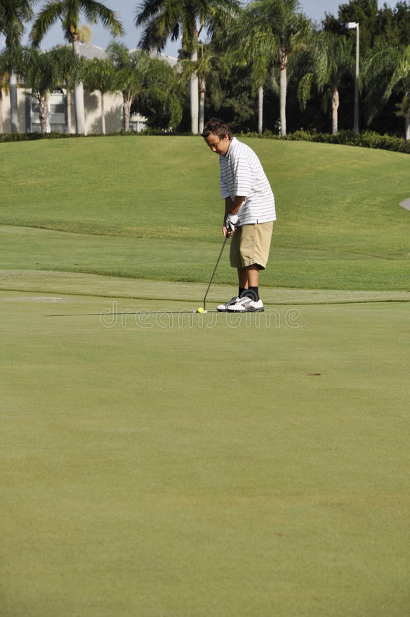 Teenage boy on golf course royalty free stock photos
