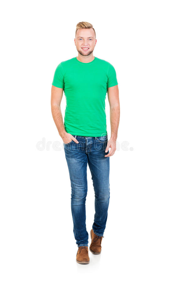 Teenage boy in a green shirt and jeans on white stock photo