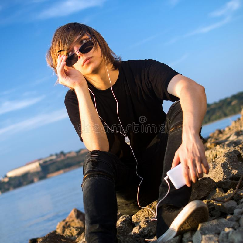 Teenage boy hanging out royalty free stock images