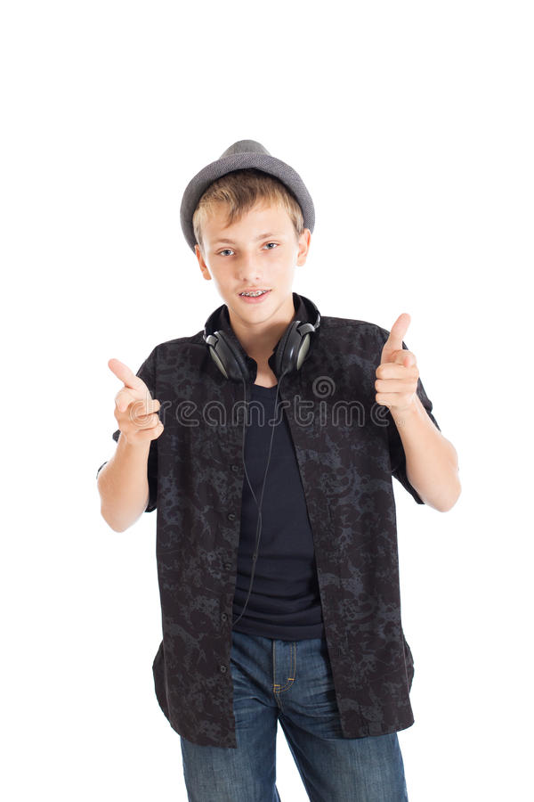 Teenage boy with headphones and guns wearing a hat. stock images