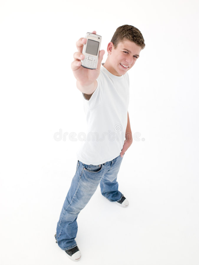 Download Teenage Boy Holding Up Cellular Phone And Smiling Stock Image - Image: 5945411