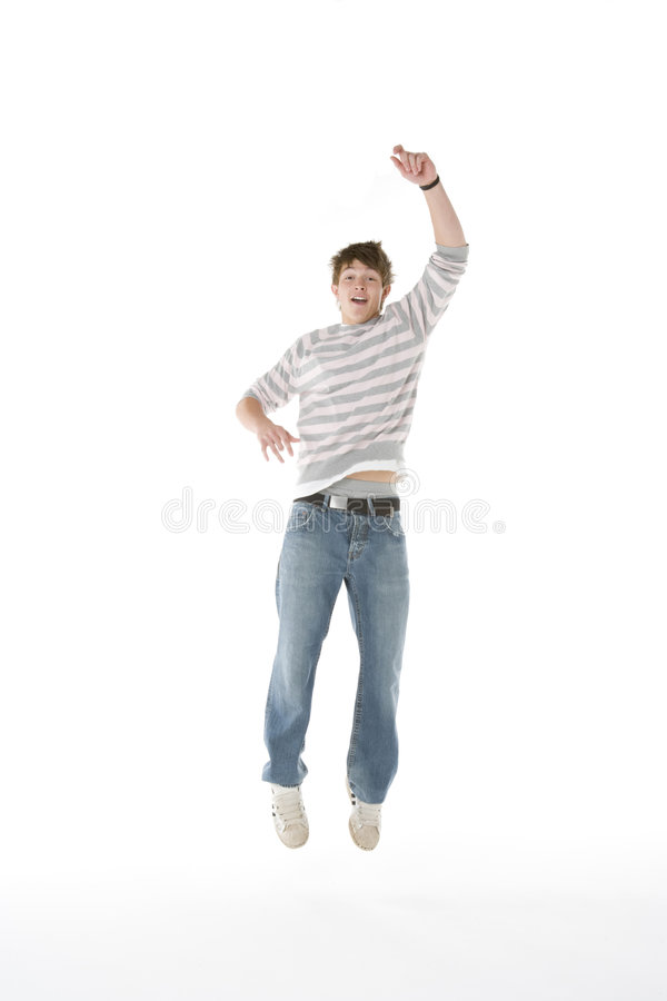 Teenage Boy Jumping In The Air Royalty Free Stock Photography