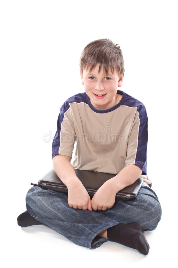 Teenage boy with a laptop stock photography