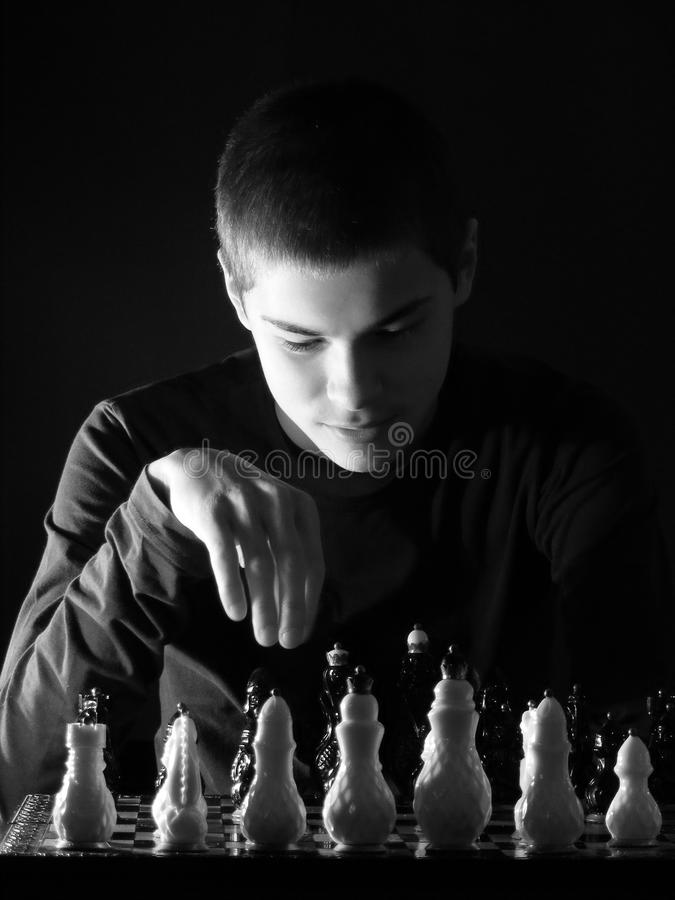Download Teenage Boy Looking At The Chessboard Stock Image - Image: 25530745
