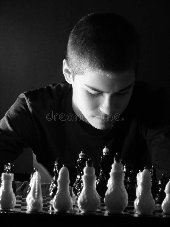 Download Teenage Boy Looking At The Chessboard Stock Photo - Image: 25530808
