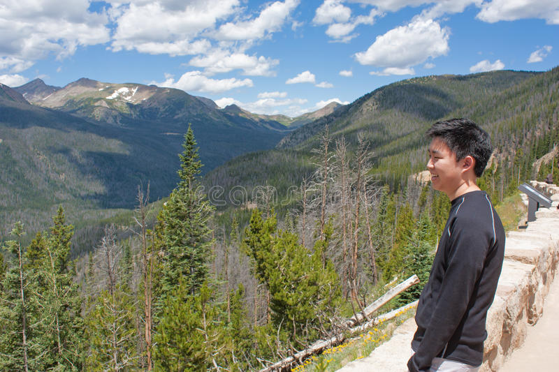 Teenage Boy Looking at the Mountains stock image