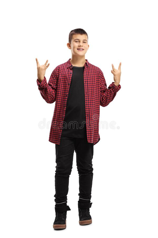 Teenage boy making a hand gesture sign of the horns stock photo