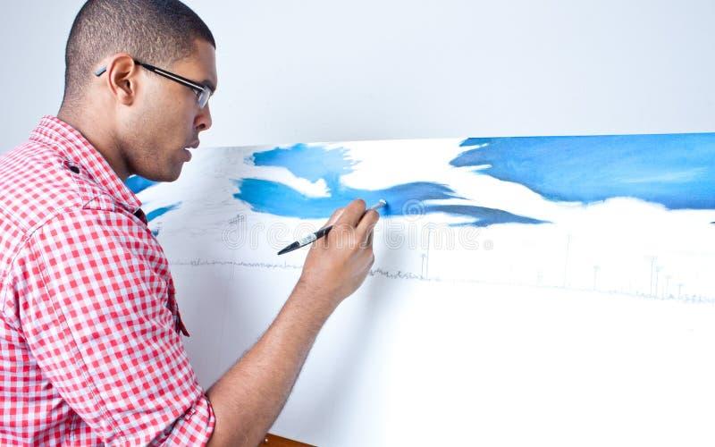 Teenage boy painting stock images