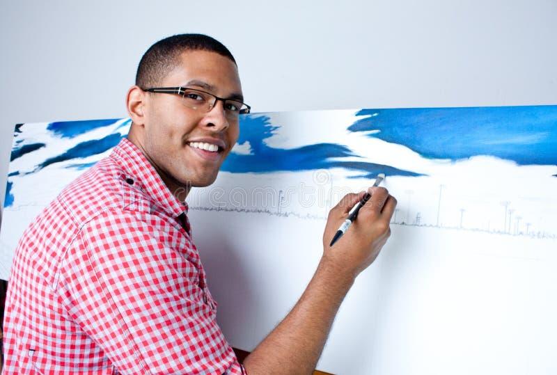 Teenage boy painting royalty free stock photography