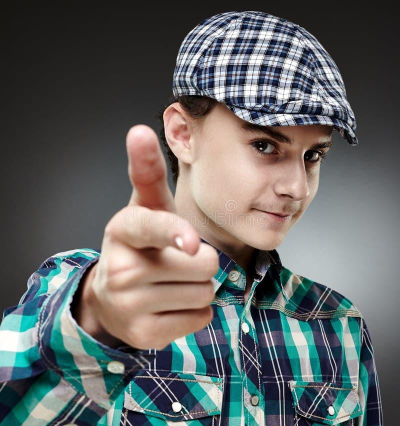 Teenage Boy Pointing At Camera Stock Photo