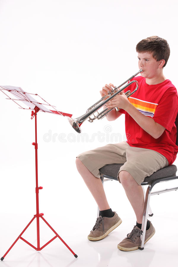 Download Teenage Boy Practicing Trumpet Stock Image - Image: 25678575