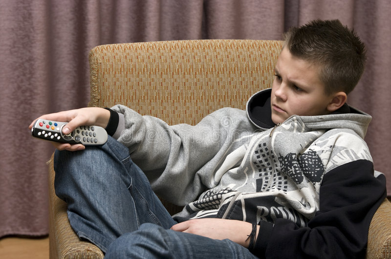 Download Teenage boy with remote stock photo. Image of channels - 7618548