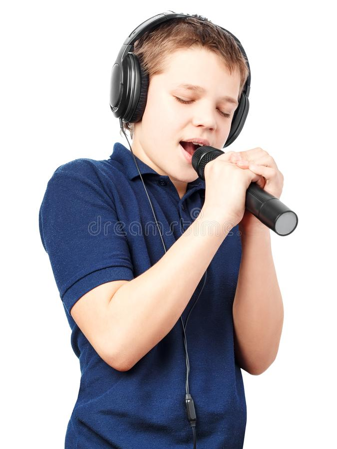 Teenage boy singing into a microphone. Very emotional. stock photo