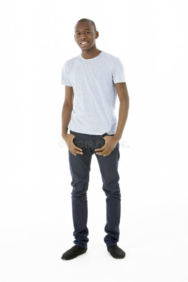 Teenage Boy Standing In Studio royalty free stock photo