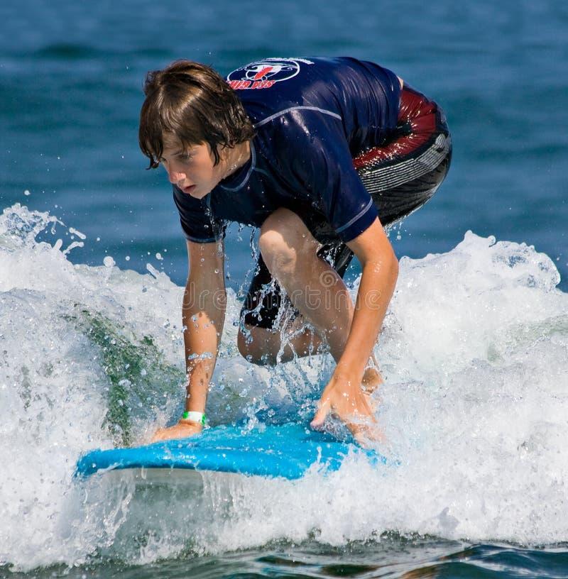 Teenage Boy Surfing stock photo