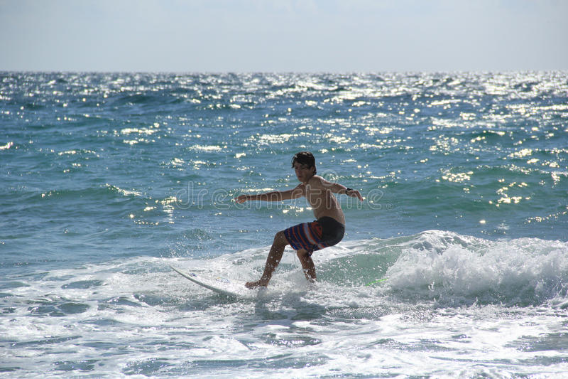 Teenage Boy Surfing Near Fort Lauderdale, Florida, United States of America stock photo