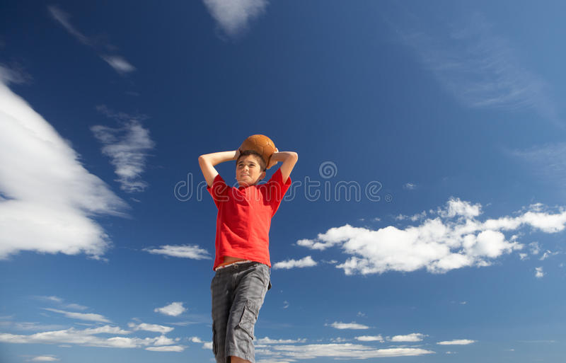 Teenage boy throwing football royalty free stock photos