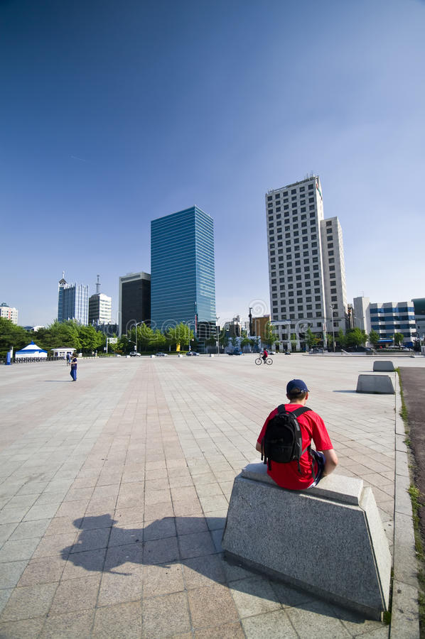 Teenage boy tourist in Seoul. A teenage boy sitting and resting while visiting Seoul, South Korea stock photo