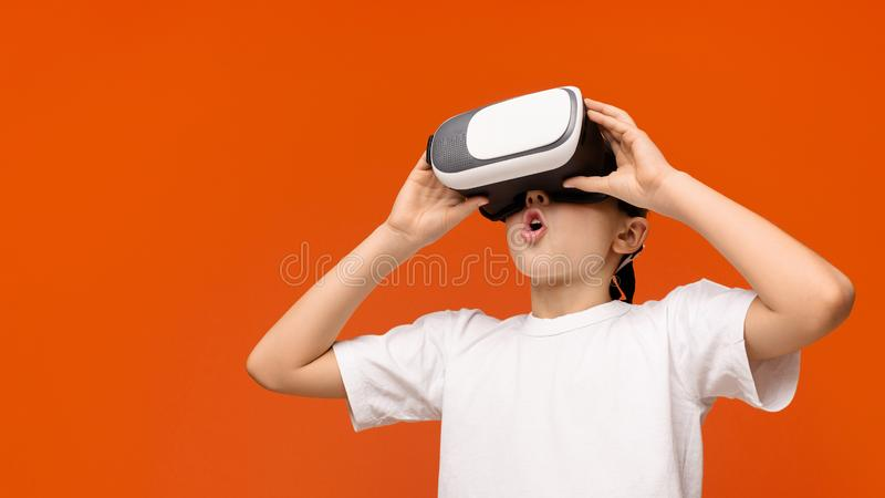Teenage boy in virtual reality glasses enjoying 3D gadget technology royalty free stock photography