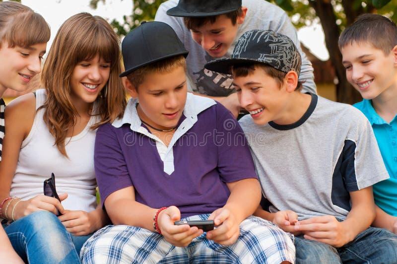 Teenage boys and girls having fun outdoor royalty free stock photos