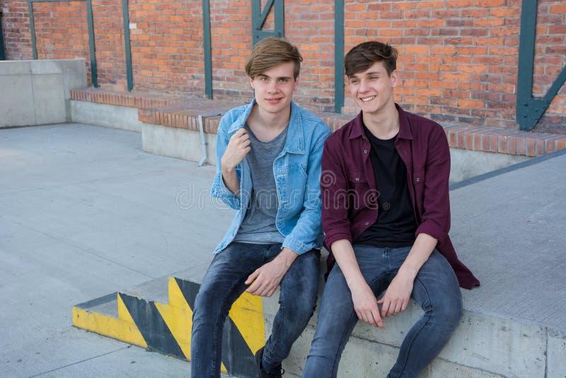 Teenage boys having fun outdoor, talking as friends stock image