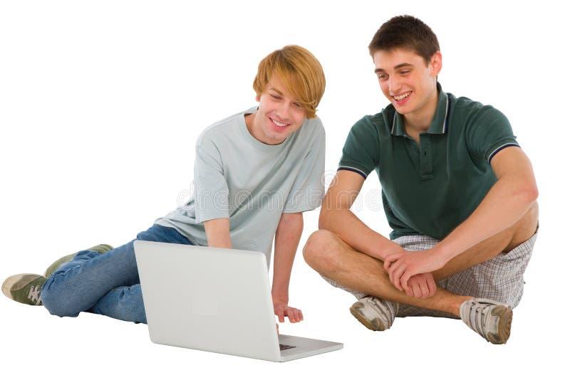 Teenage boys with laptop royalty free stock photo