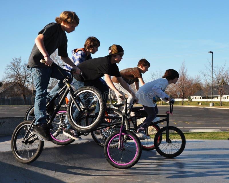 Teenage Boys riding Bikes royalty free stock photos