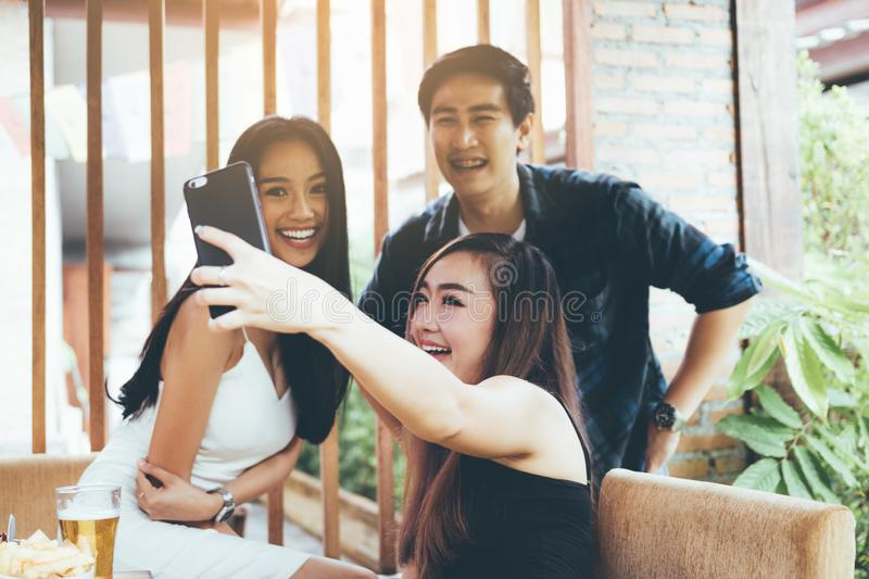 Teenage brides are having fun in the party and using mobile phone talking selfie photo royalty free stock photography