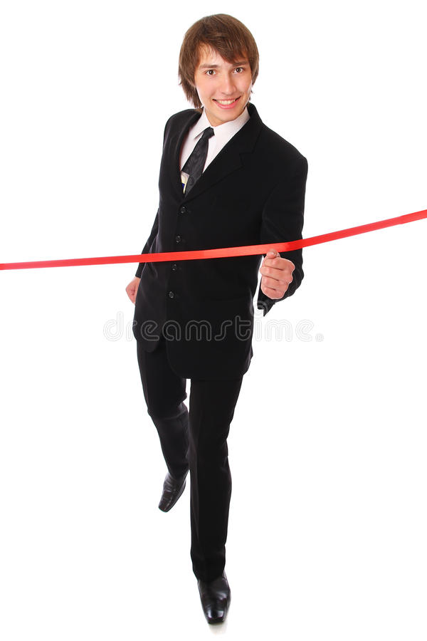 Teenage businessman is running at red line. royalty free stock photo
