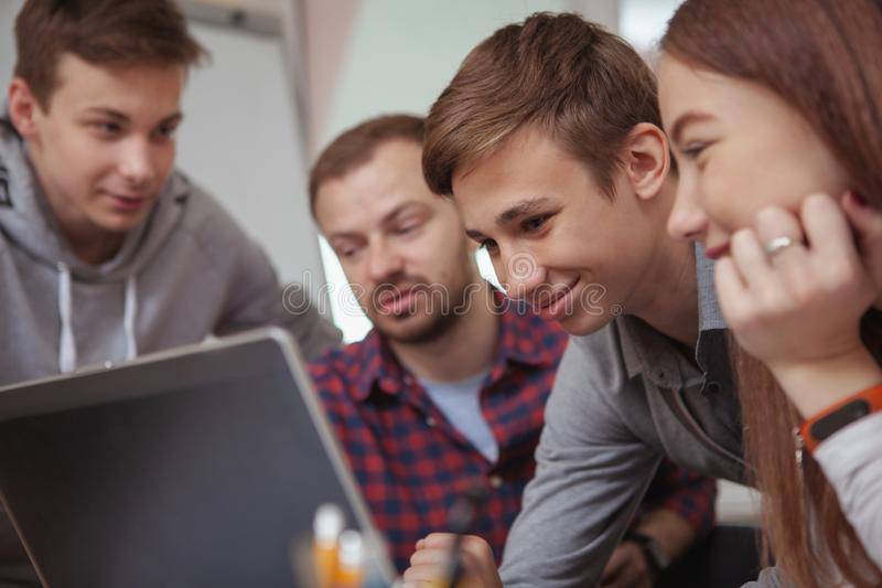 Teenage classmates studying together stock image