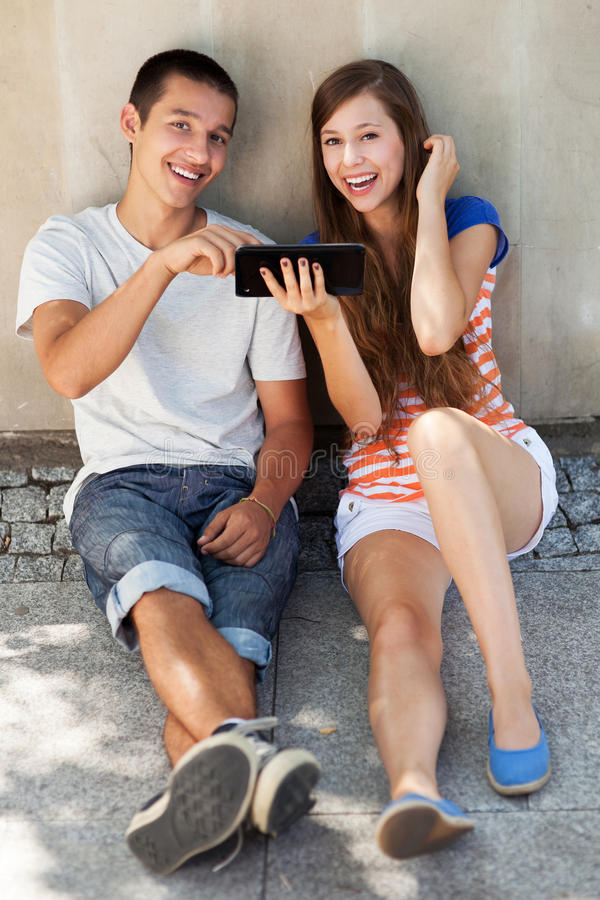 Teenage Couple With Digital Tablet Stock Image