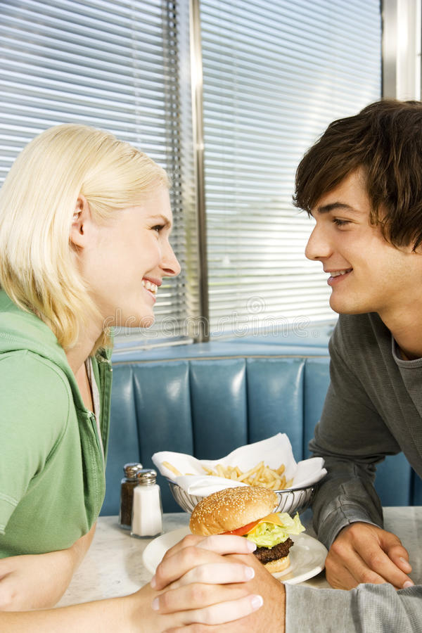 Teenage couple in a diner royalty free stock photos