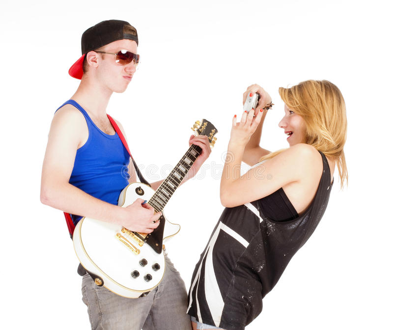Teenage Couple - Girl Taking Pictures of her Boyfriend with Guitar stock images
