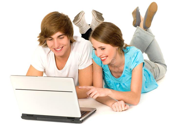 Download Teenage couple with laptop stock photo. Image of cheerful - 12092716