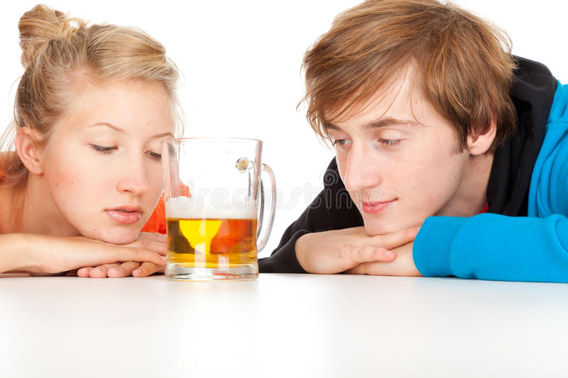 Download Teenage Couple Leaning On Table With Beer Stock Photo - Image: 21779094