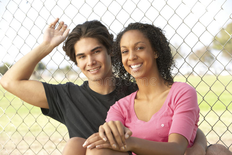Teenage Couple Sitting In Playground Royalty Free Stock Images