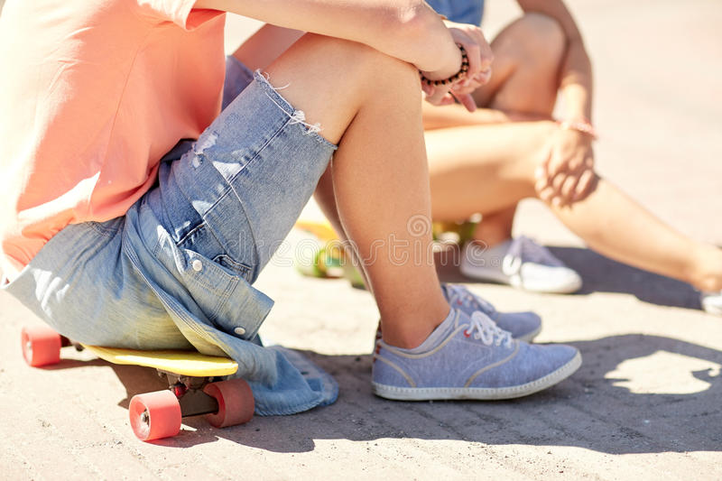 Teenage couple with skateboards on city street. Summer holidays, extreme sport and people concept - close up of teenage couple with short modern cruiser stock photo
