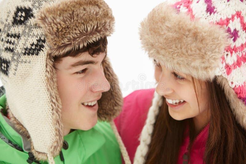 Teenage Couple In Snow Wearing Fur Hats