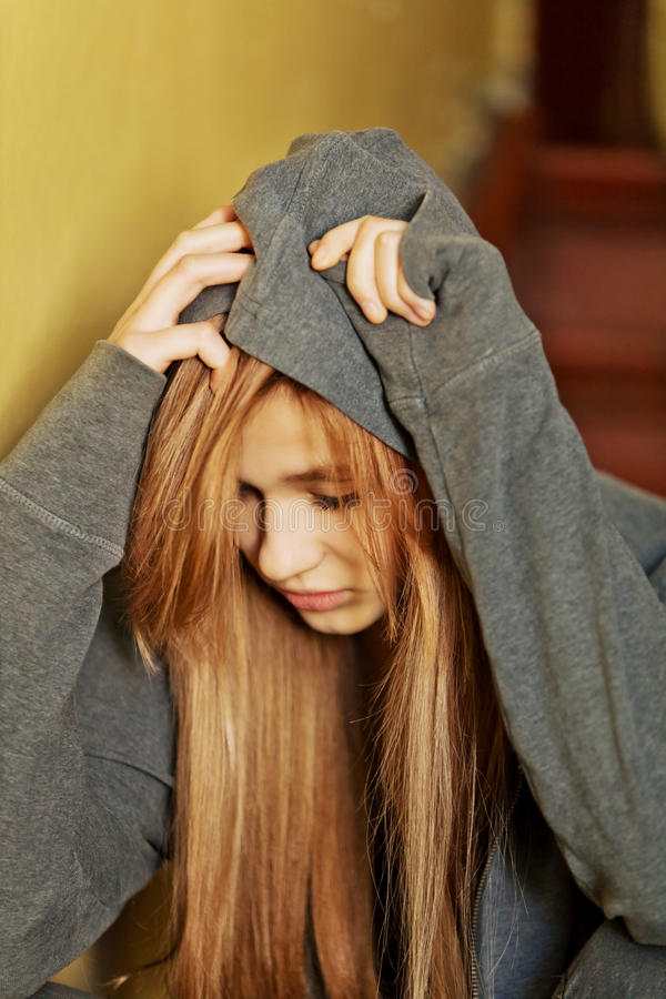 Teenage depressed woman sitting on stairscase stock image