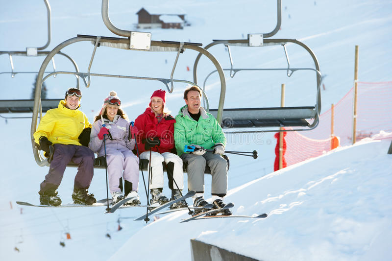 Teenage Family Getting Off Chair Lift On Holiday. Teenage Family Getting Off Chair Lift On Ski Holiday In Mountains stock images