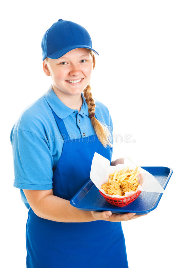 Teenage Fast Food Worker. Teenage worker serving a fast food meal. Isolated on white royalty free stock photo