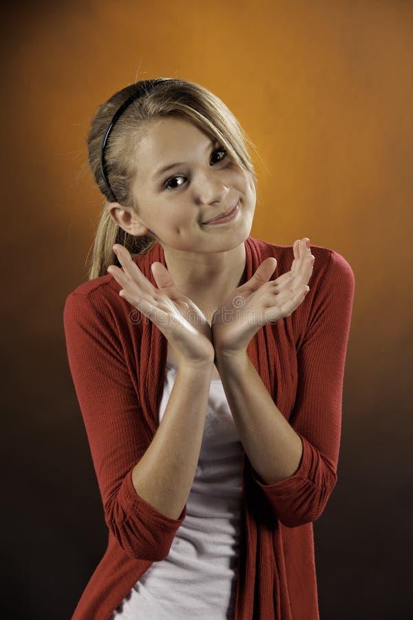 Teenage female girl against orange royalty free stock photo