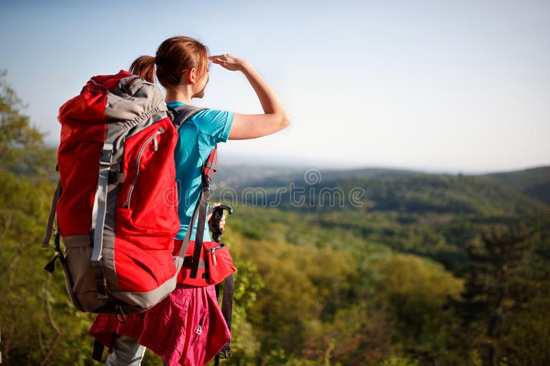 Teenage female hiker watching in distance stock photos