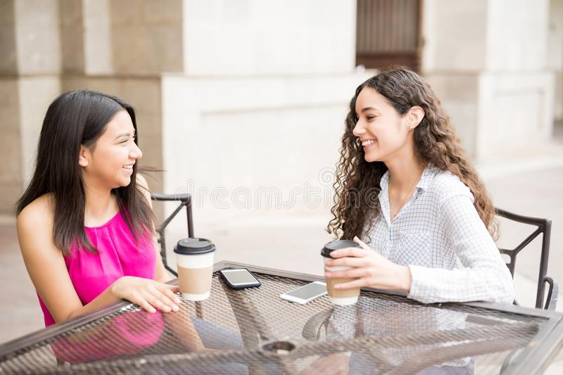 Teenage friends hangout at cafe royalty free stock image